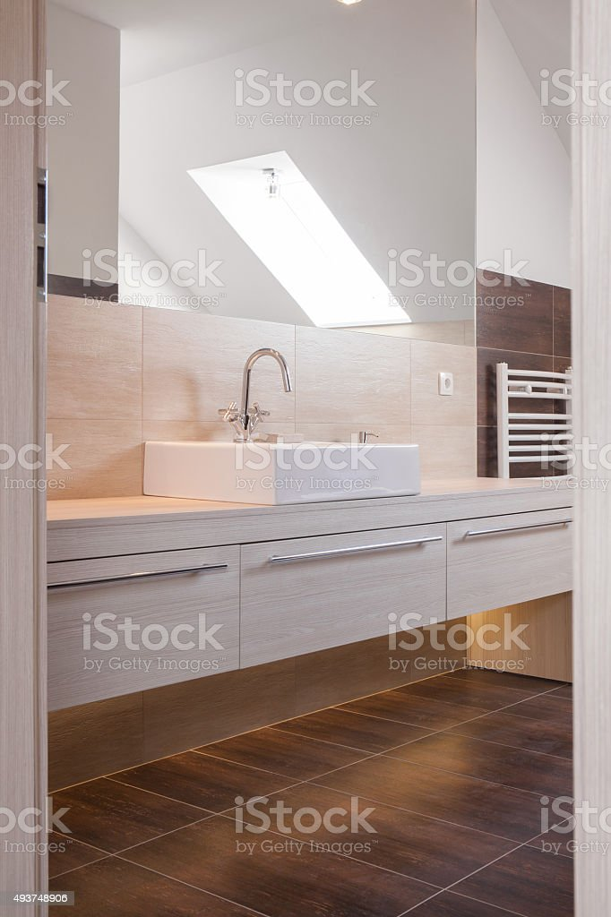 Beige and brown bathroom design stock photo