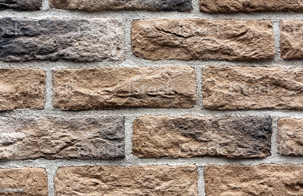 Beige and gray brick wall surface. stock photo