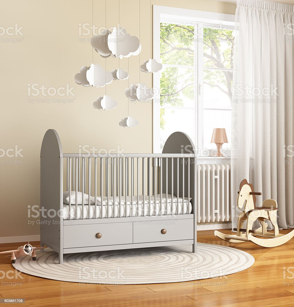 Beige and grey nursery baby room with rug stock photo