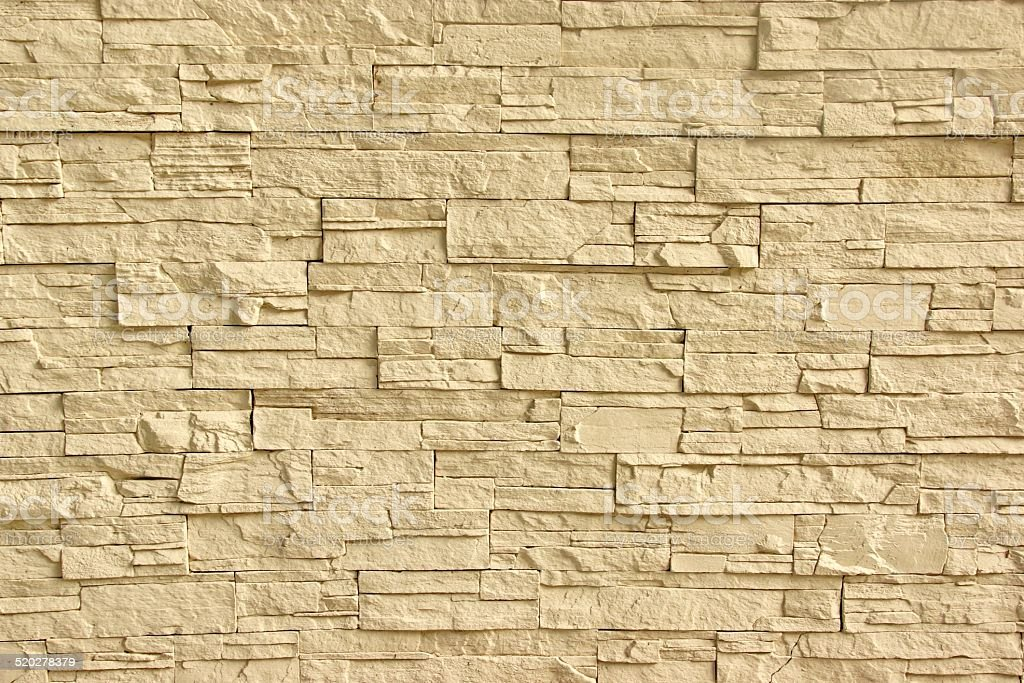 Beige Artificial Stone Wall stock photo