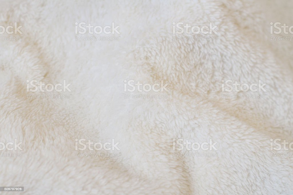 Beige background of plush fabric stock photo