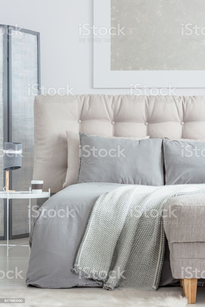 Beige bed with pillows stock photo