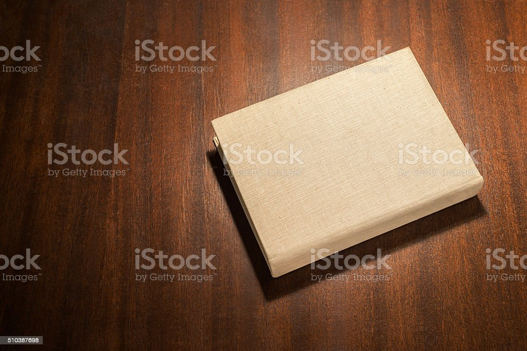 Beige book on the table stock photo