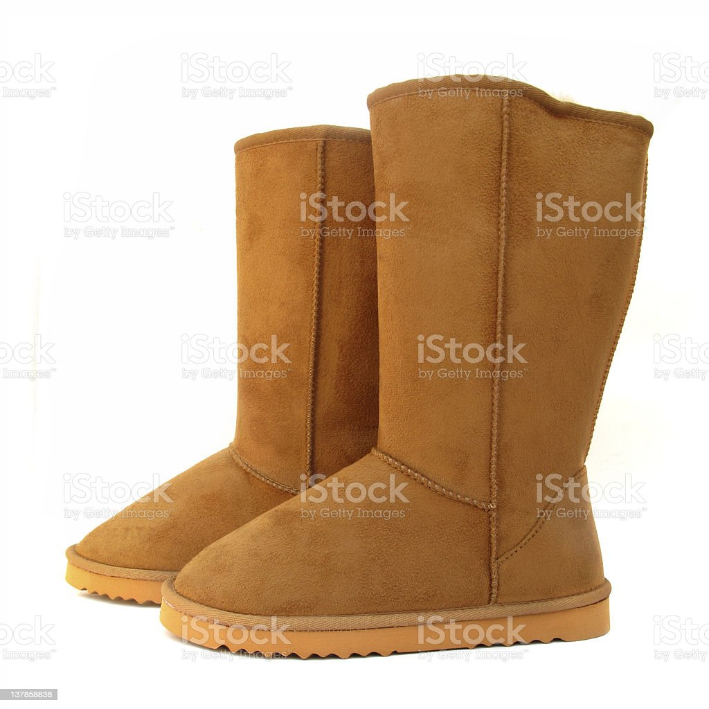 Beige boots on white background stock photo