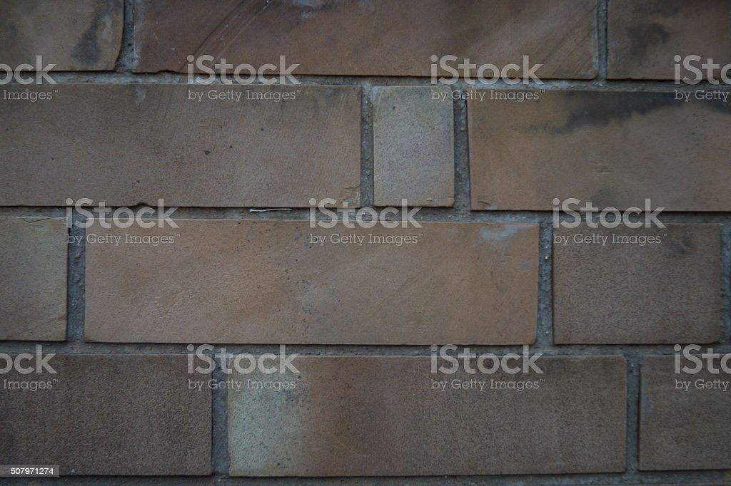 beige brick wall with water damage stock photo