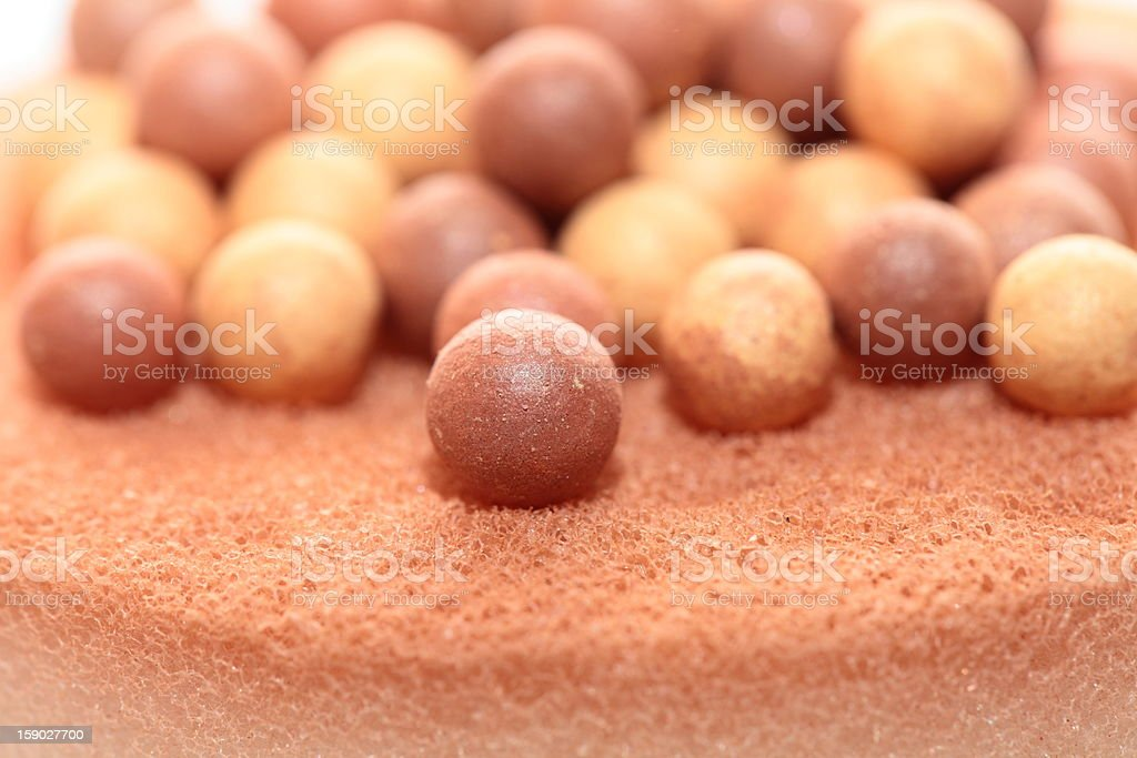 Beige cosmetics multicolor rouge balls background, macro view royalty-free stock photo
