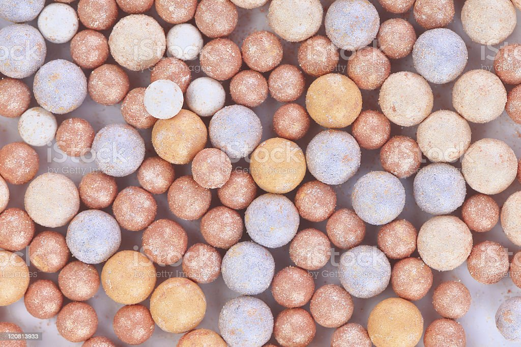 Beige cosmetics multicolor rouge balls background royalty-free stock photo