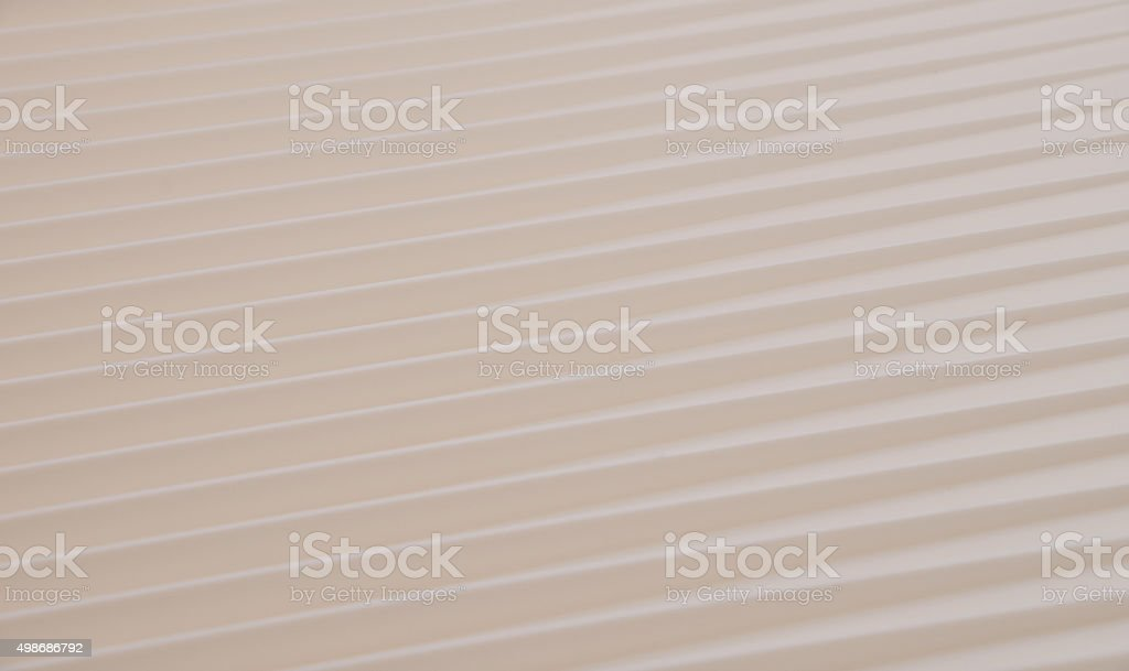 Beige diagonal lines with contrary directions royalty-free stock photo