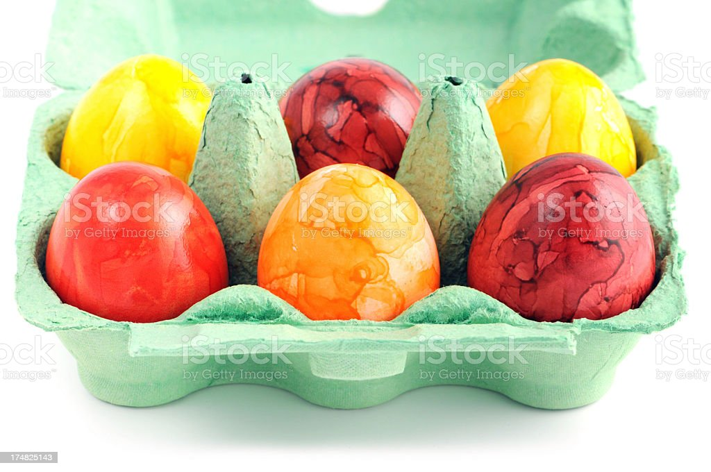 beige eggs with young chicken and feather in green carton royalty-free stock photo