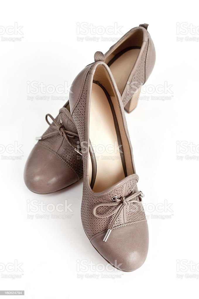 Beige female shoes on a light background royalty-free stock photo