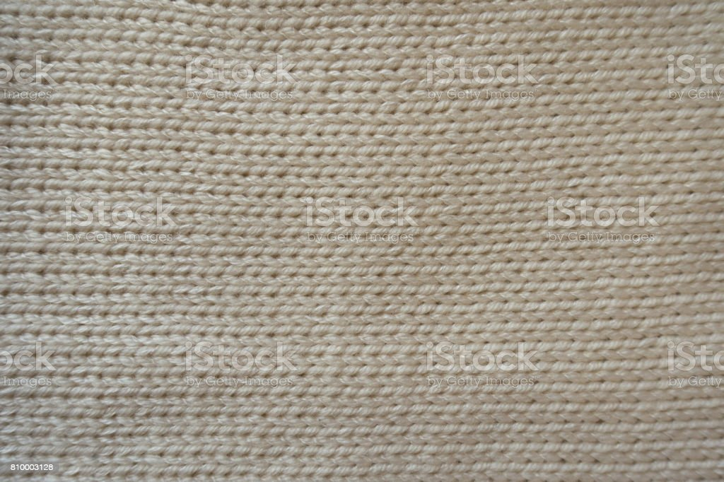 Beige handmade stocking stitch fabric from above stock photo