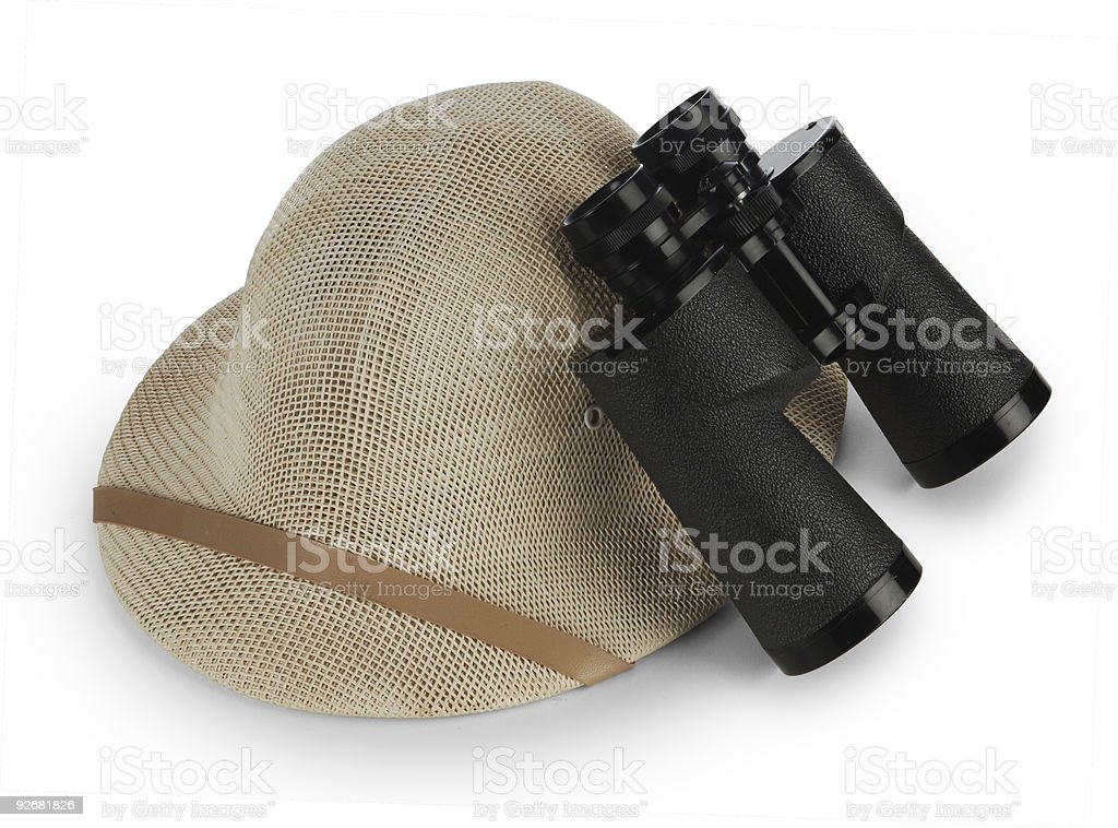 Beige hat next to black binoculars safari concept royalty-free stock photo