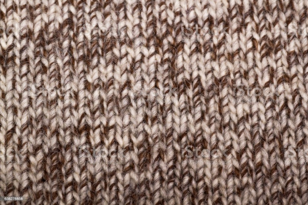 beige knitted fabric as background stock photo