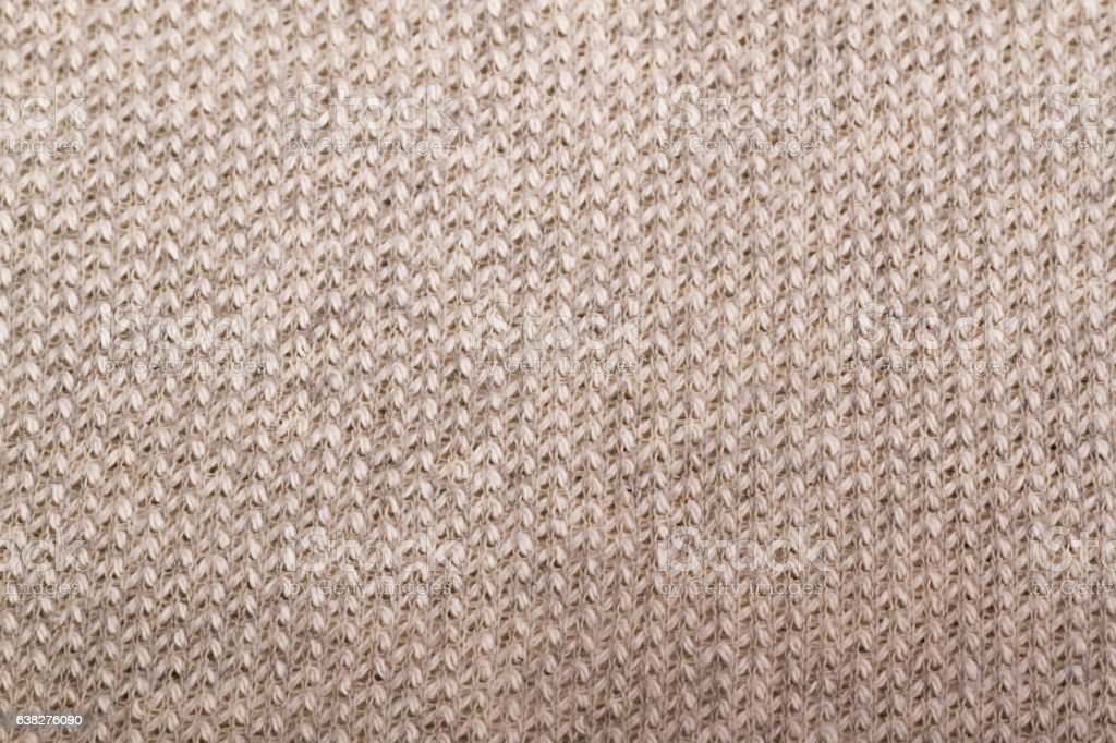 beige knitted fabric textured background stock photo