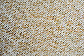 Beige knitted woolen fabric texture