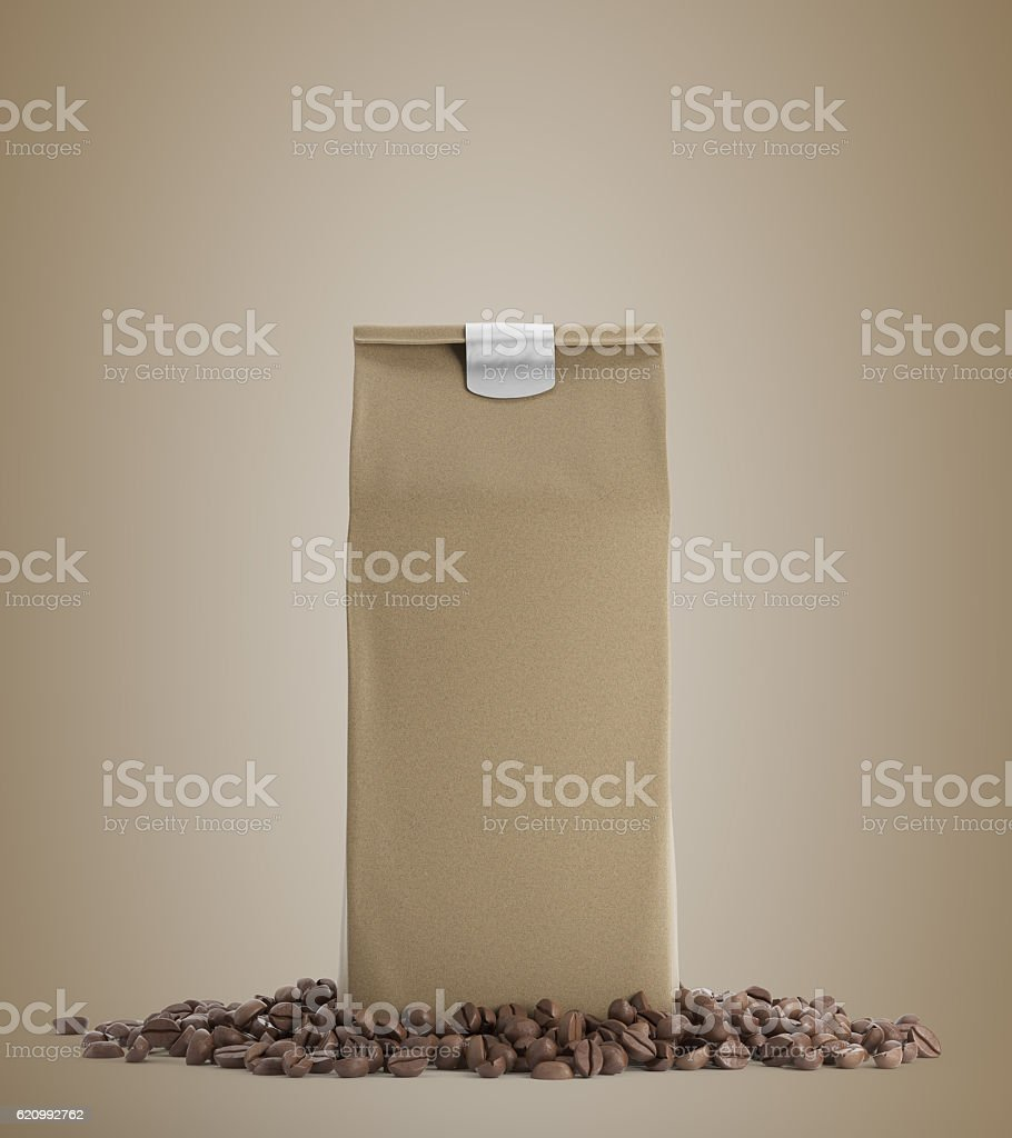 Beige pack of coffee against beige background stock photo