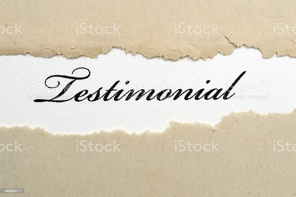 Beige paper torn across the middle revealing testimonial stock photo
