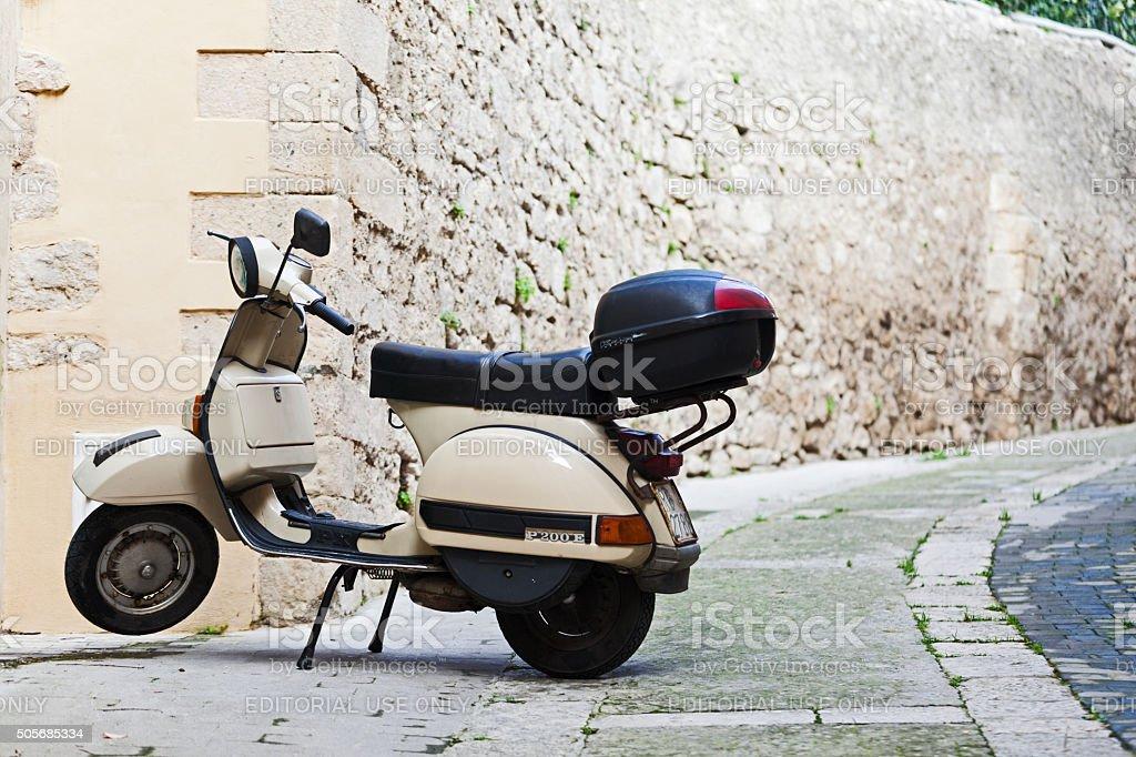 Beige Piaggio Vespa P200E scooter parked in Ragusa, Sicily, Italy. stock photo
