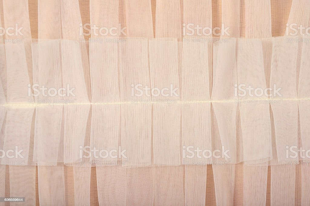 Beige pleated transparent caprone cloth as background texture stock photo