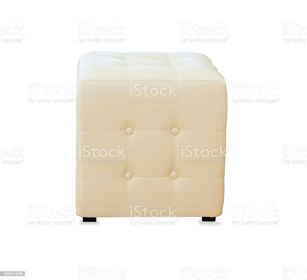 Beige pouf ottoman isolated over white stock photo