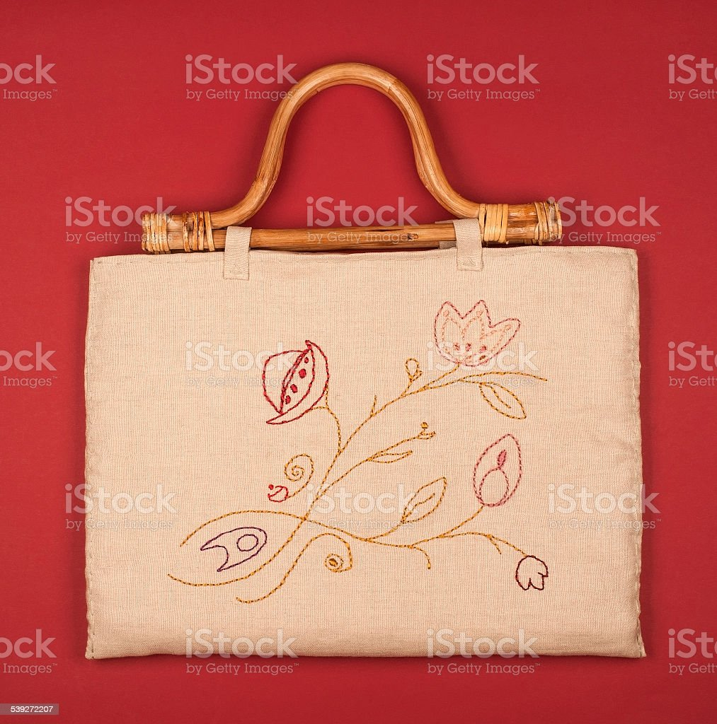 Beige purse with floral pattern stock photo