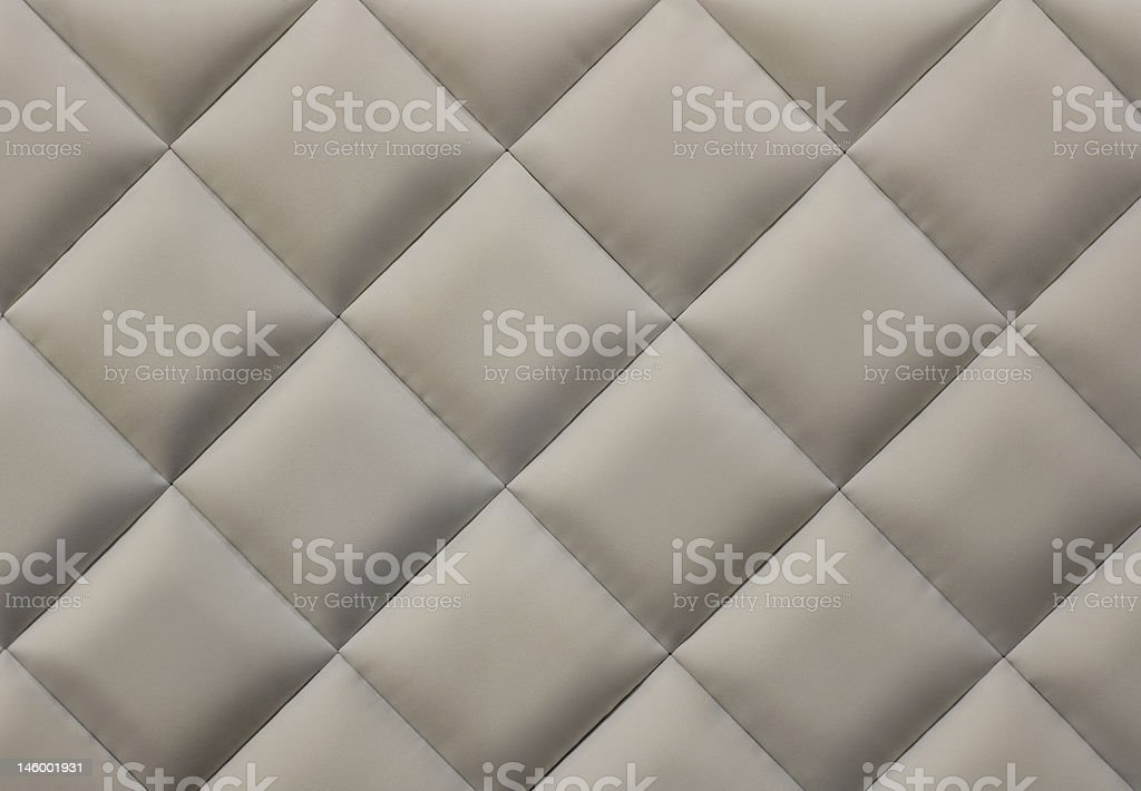 Beige quilted background stock photo