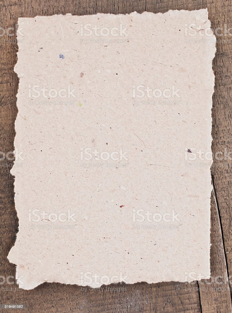 beige recycled paper on wood stock photo