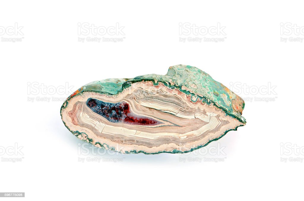 beige red blue sliced agate on isolated white background stock photo