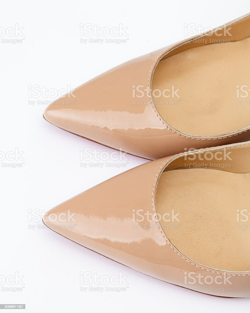 Beige shoes on white background stock photo