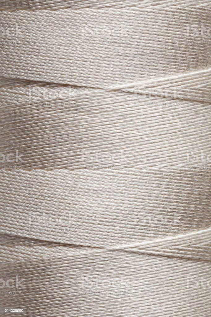 Beige spool of thread stock photo