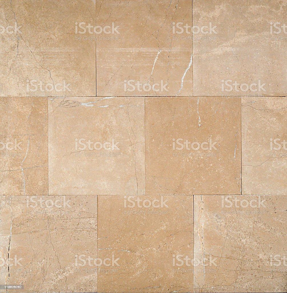Beige square tiles with stone texture stock photo