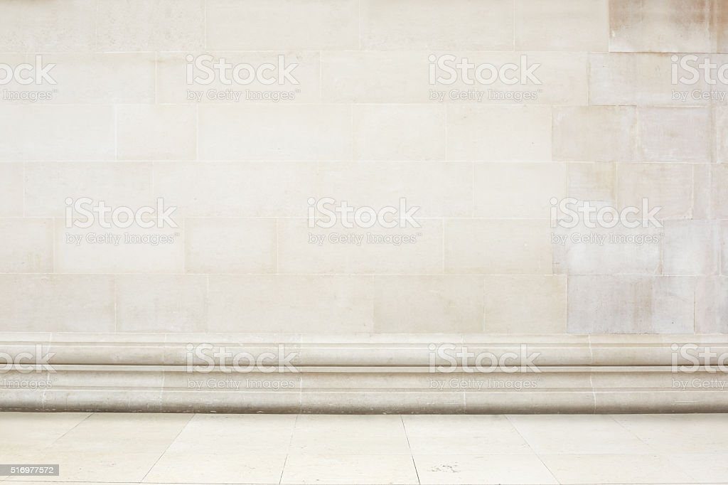 Beige stone tiled wall and floor with decoration border stock photo
