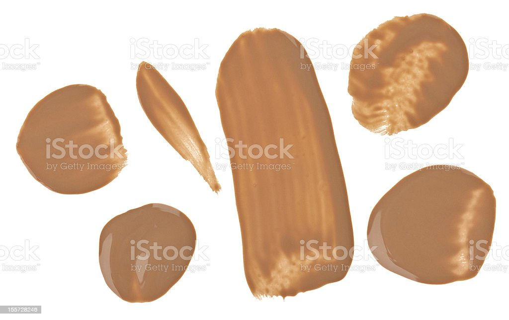 Beige tone cream (foundation) makeup samples, isolated on white royalty-free stock photo