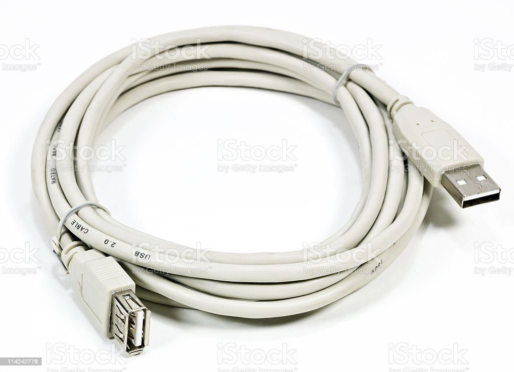 beige usb extender cable coiled up stock photo