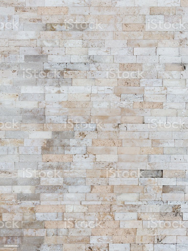Beige wall made of natural travertine stock photo