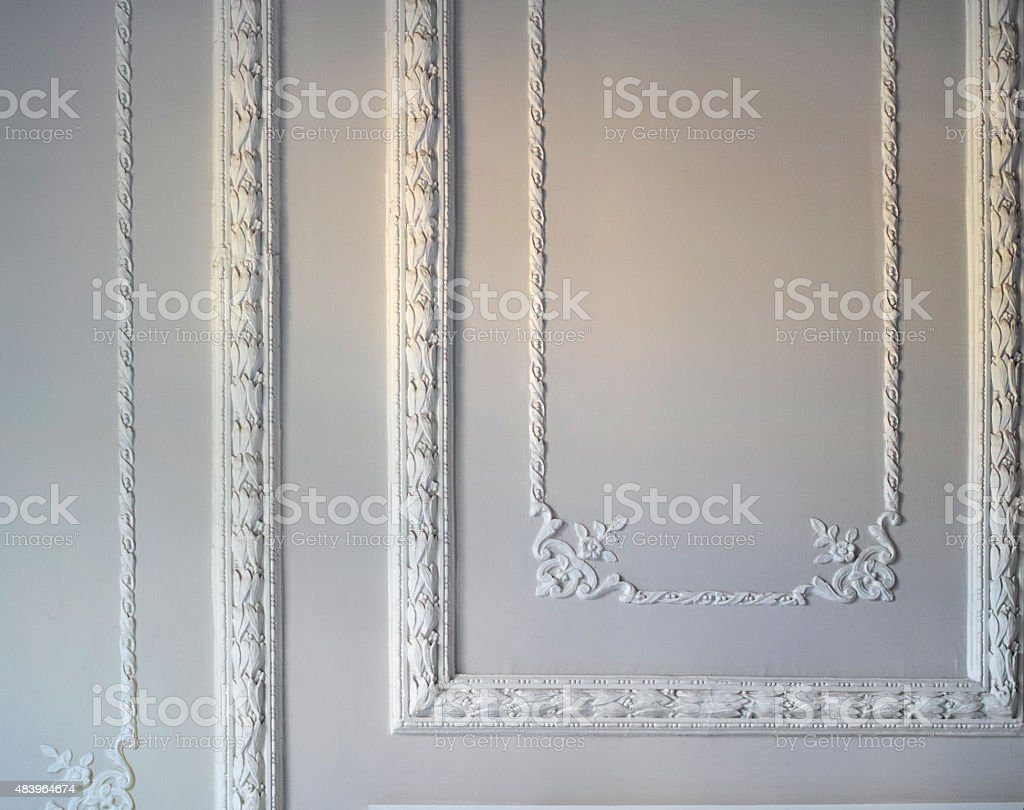 Beige Wall With Decoration From Artistic Plasterwork At Ancient Building stock photo