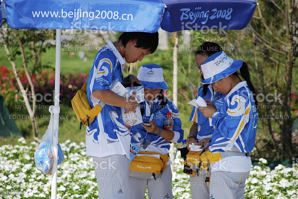 Beijing 2008 Olympic Games volunteers in official uniforms royalty-free stock photo