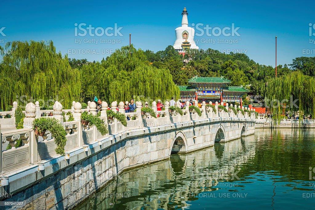 Beijing crowds enjoying summer sunshine in Beihai Park China stock photo
