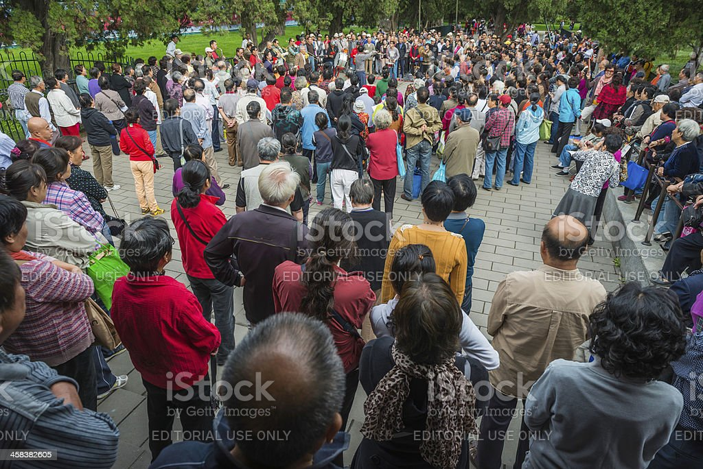 Beijing crowds singing with orchestra Temple of Heaven Park Chin stock photo