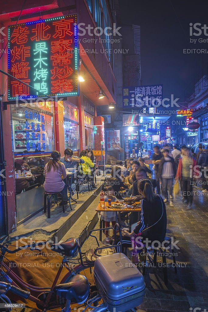 Beijing diners at crowded night market restaurant China royalty-free stock photo
