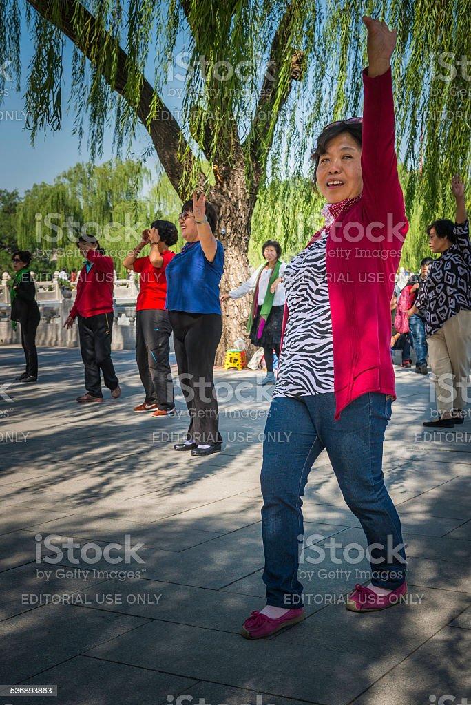 Beijing group of women exercising in Beihai Park China stock photo
