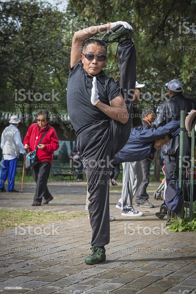 Beijing local man exercising in Temple of Heaven park China royalty-free stock photo