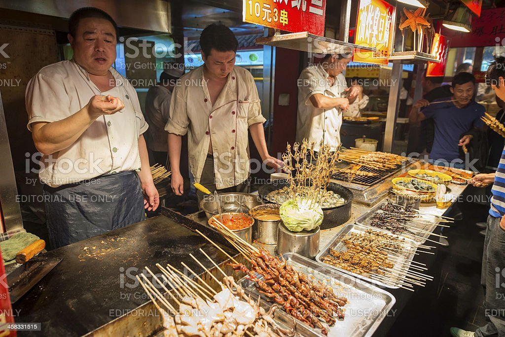 Beijing night market food stalls selling local delicacies China royalty-free stock photo