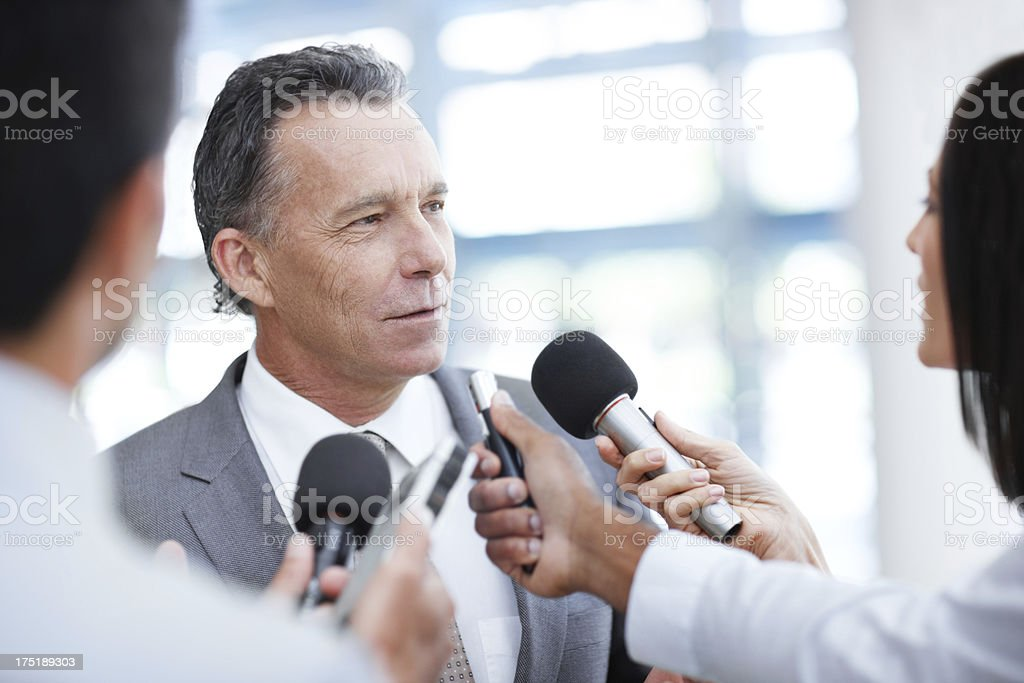 Being bombarded with questions stock photo