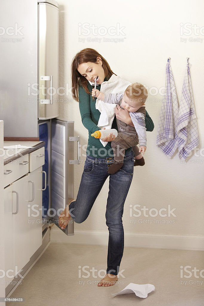 Being mom is a balancing act! stock photo