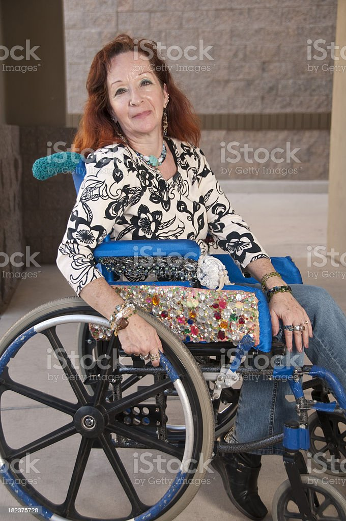 Bejeweled Woman in a Wheelchair royalty-free stock photo