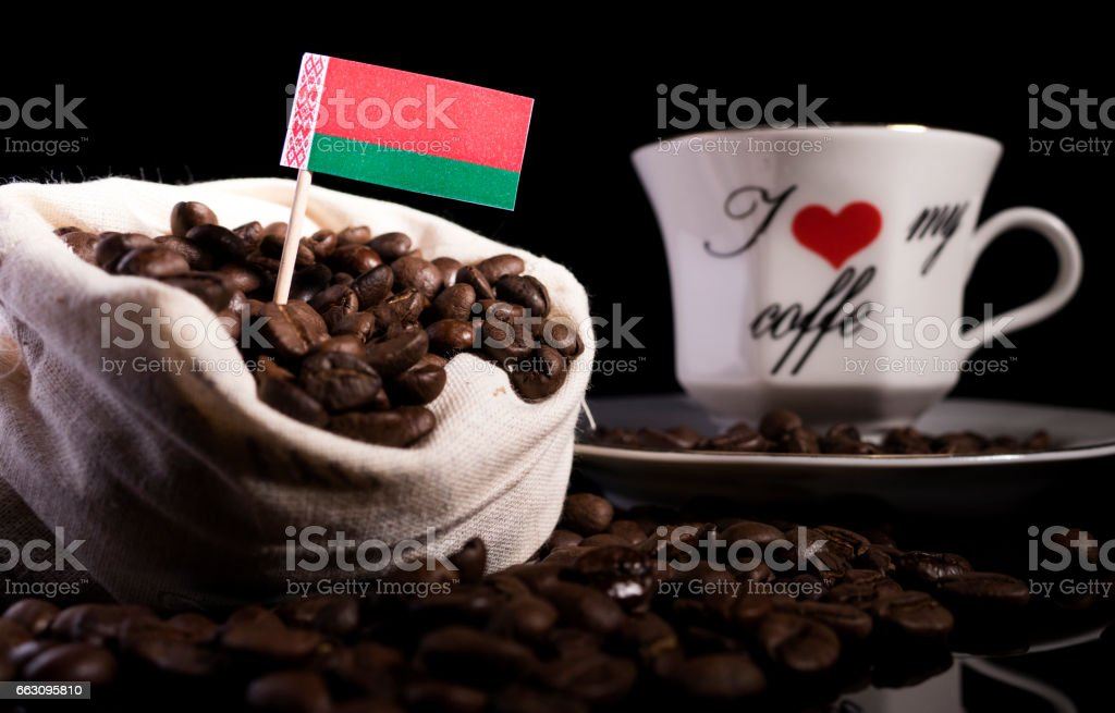 Belarus flag in a bag with coffee beans isolated on black background stock photo
