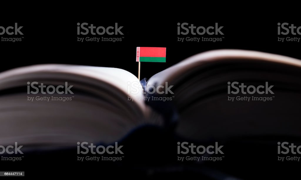 Belarus flag in the middle of the book. Knowledge and education concept. stock photo