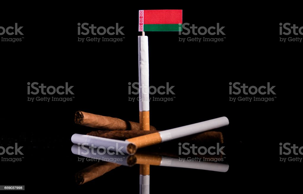 Belarus flag with cigarettes and cigars. Tobacco Industry concept. stock photo