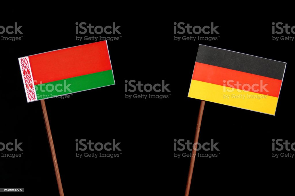 Belarus flag with German flag isolated on black background stock photo